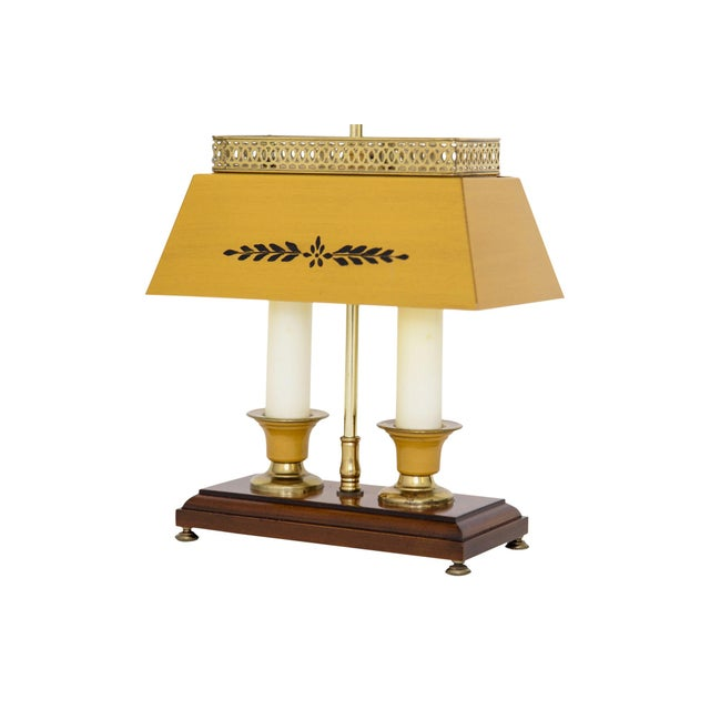 Rectangular bouillotte-style lamp with pierced brass gallery. The metal shade and candle holders are painted in yellow...