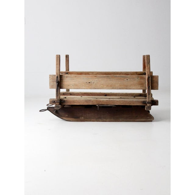 This is an antique primitive farm sled circa late 19th century. The rustic wooden farm tool features removable sides that...