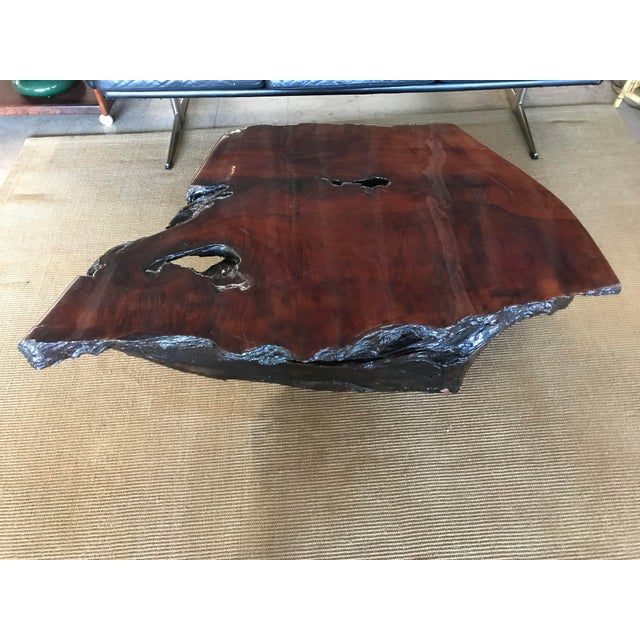 Amazing 1960's live edge slab coffee table with a light and a dark stain side on base. One side of base is lighter golden...