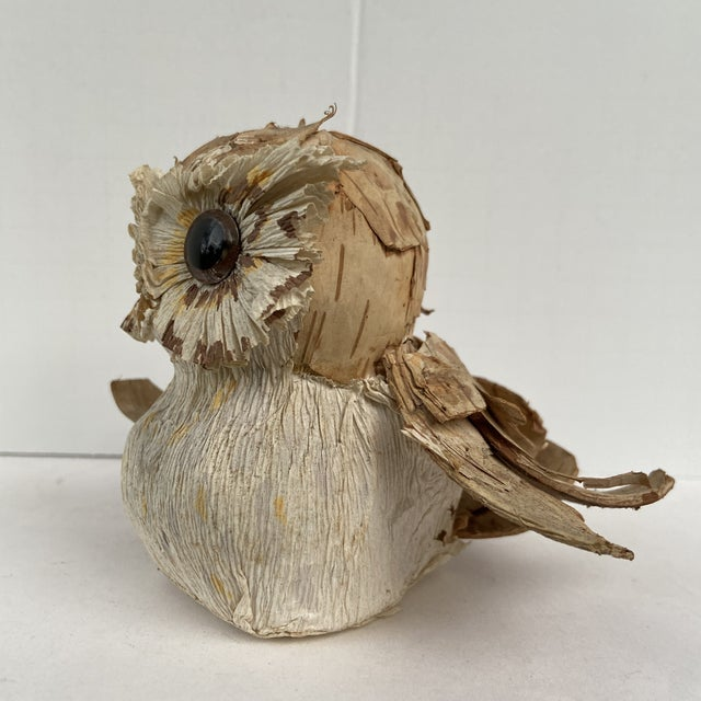 An Organic hand made Owl. Texture is created by each feather being a piece of wood bark. It's then hand painted over the...