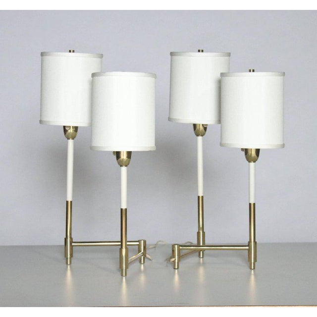 Pair of adjustable candelabra table lamps in the style of Tommi Parzinger with new custom shades. Each fixture extends to...