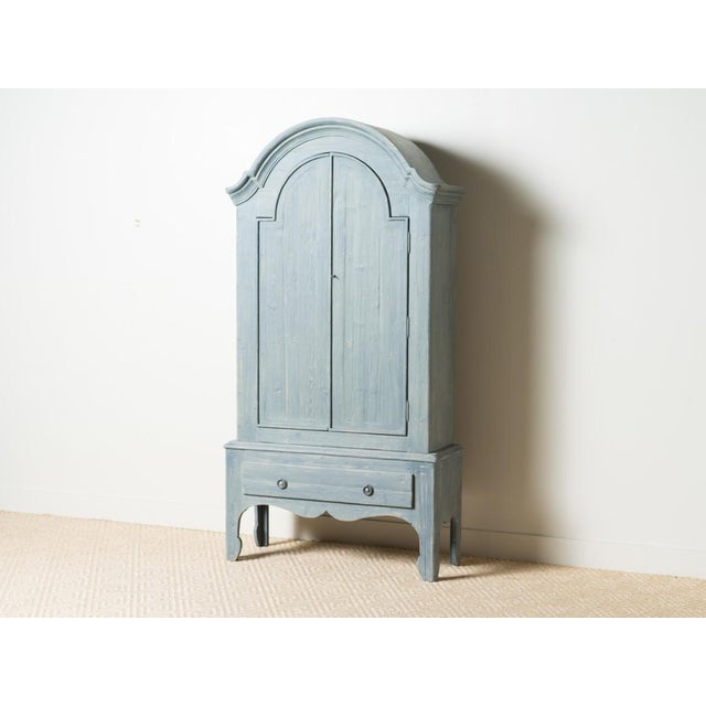 Dark blue/gray stained wooden canopy armoire Two doors and single drawer