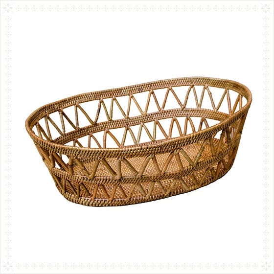 Gorgeously hand-woven ate basket with an open design -- perfect for serving bread, fruit or just holding anything you'd...