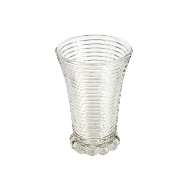 Large vintage sparkling optic glass vase with a ribbed design and bead glass foot. No maker's mark. Light wear.