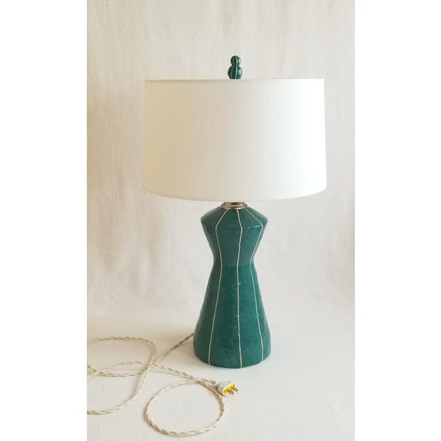 The futuristic tapering form of Seattle's Space Needle and mid-century modern design were my inspirations for this lamp....