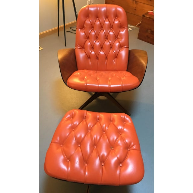 Mid-Century Modern Orange Plycraft lounge chair and matching ottoman, faux-leather recently restored and wood re-...