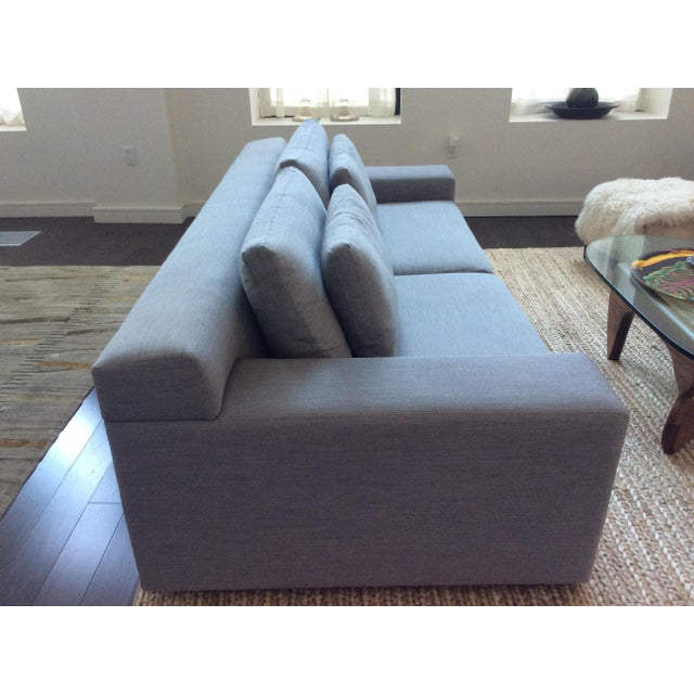 Contemporary modern sofa with seamless, clean lines. Design Within Reach. Relaxed sit and comfortable. Light grey.