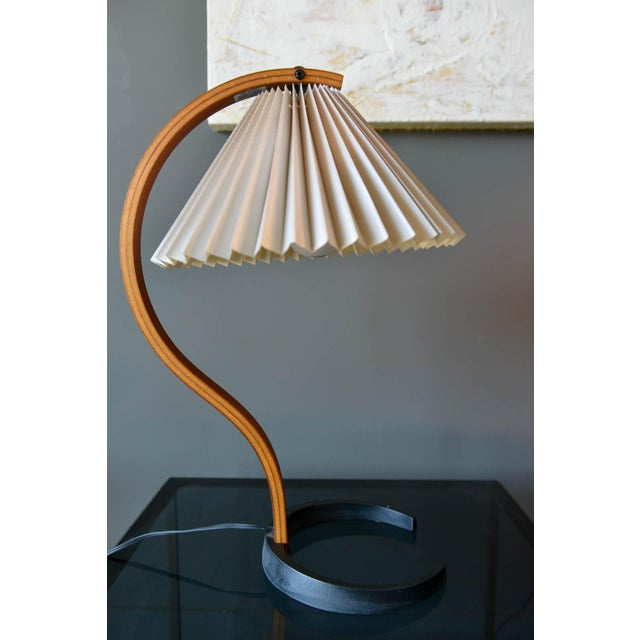 Mads Caprani floor lamp, circa 1971 by Danish manufacturer Caprani Light AS. This vintage lamp features sculptural bent...