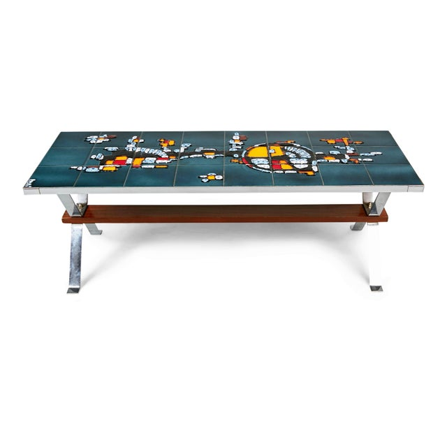 Beautifully crafted chrome and ceramic tile coffee table, circa 1960, Italy. This slenderly proportioned cocktail table...
