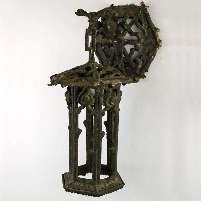 This 1920's hexagonal garden lantern is cast of iron and in the pattern of grape vine twigs. We have left the existing...