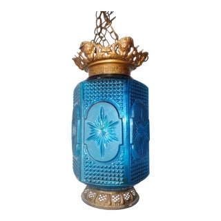 Early 20th Century Ornate Brass Mounted Blue Glass Hanging Swag Lamp For Sale