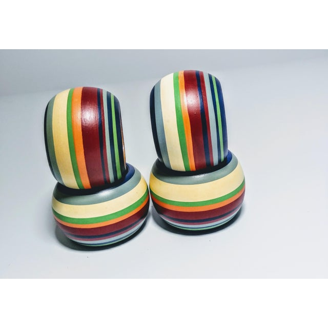 Set of Four Vintage multi Colored Striped Napkin Rings Deep Red Orange Green White Grey And Navy Stripes The inside is...