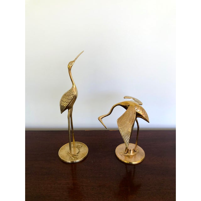 Polished vintage brass cranes or heron birds. A great vintage set for your boho chic, Hollywood Regency, or mid-century...