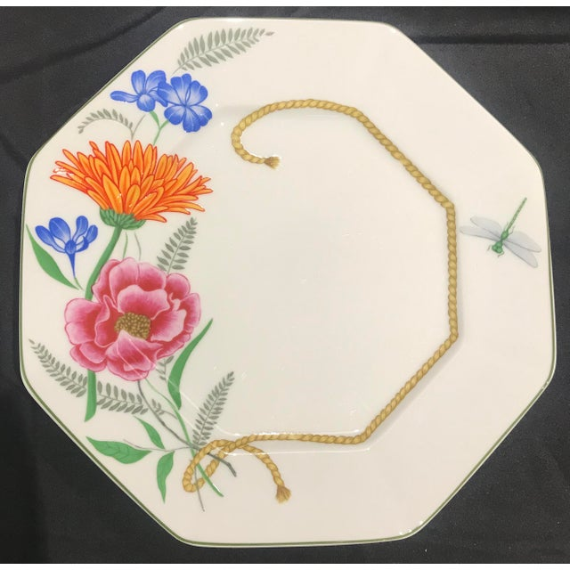 """This assorted set of Lynn Chase 10 1/4"""" Flores dinner plates features a beautiful multi sided motif of colorful bugs,..."""