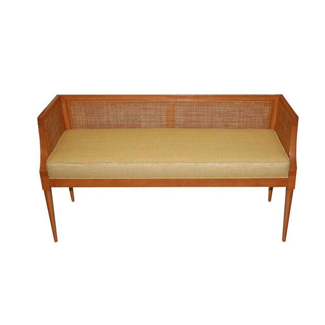 Mn Originals solid maple bench with inset natural caning fitted with a tight upholstered seat. COM requirements: 3 yards...