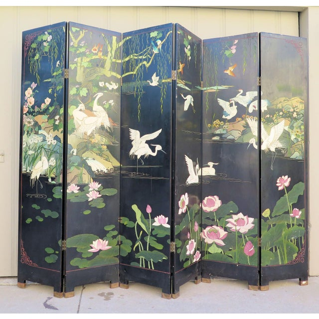 "This outstanding screen has a bird and floral motif that include cranes swans and lily pads with the ""sacred"" Lotus..."