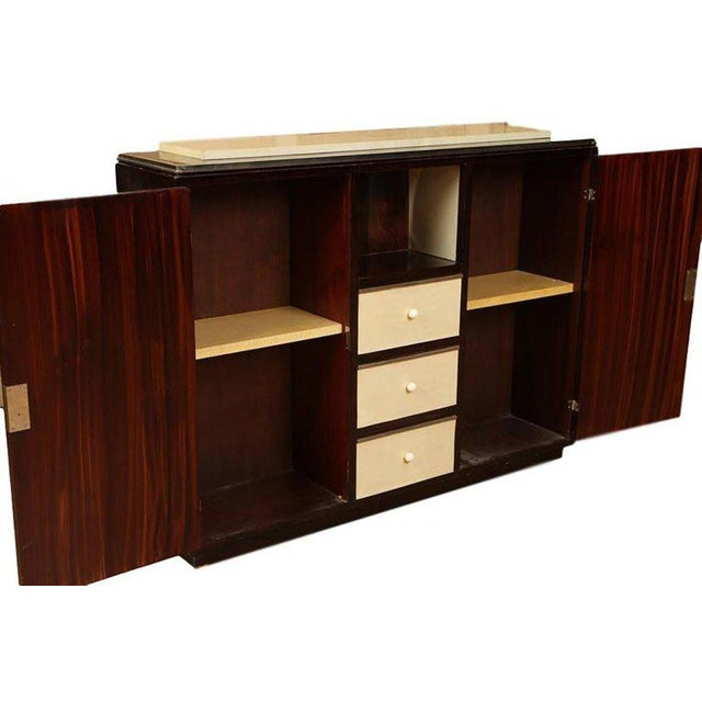 Mid-century modern Palisander and parchment cabinet. French, circa 1940. Measures: H 41.5, W 53.5, D 12.5.