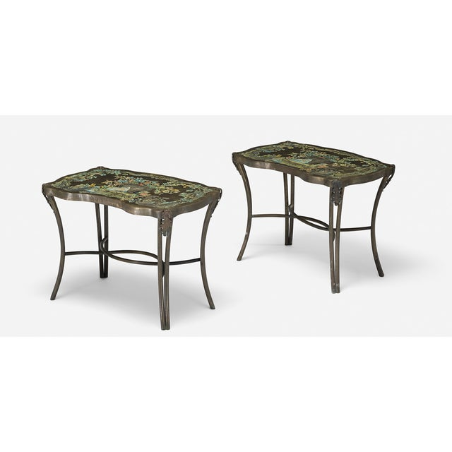 Madame Pompadour End Tables in Acid Etched Bras. urn and watering can are the motif in the etching. Etched signature to...