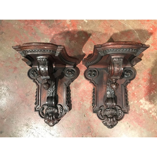 This fine pair of antique fruit wood wall brackets was crafted in France circa 1860. Each of the hand carved brackets has...