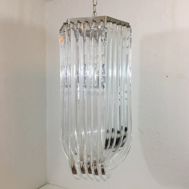 Being offered to be added to your collection is a vintage MONUMENTAL lucite ribbon chandelier. Perfect for double height...