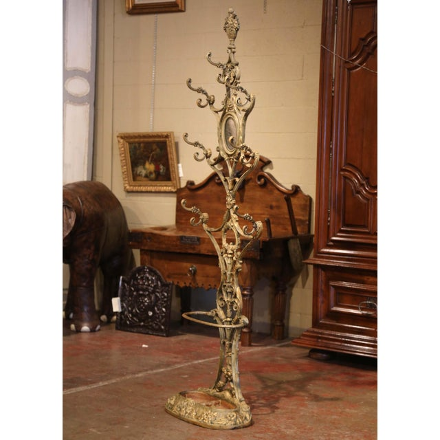 Place this elegant antique hall tree in an entry or a mud room to catch coats, hats and umbrellas. Crafted in France circa...