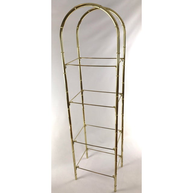 "This etagere frame is made from golden brass Space for four glass shelves (not included) Measures 16.5"" wide x 12.5"" deep..."
