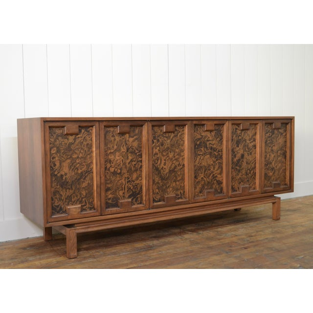 James Mont style mid century credenza. Unique details and extra long design. Walnut cabinet. Burled doors ready for your...