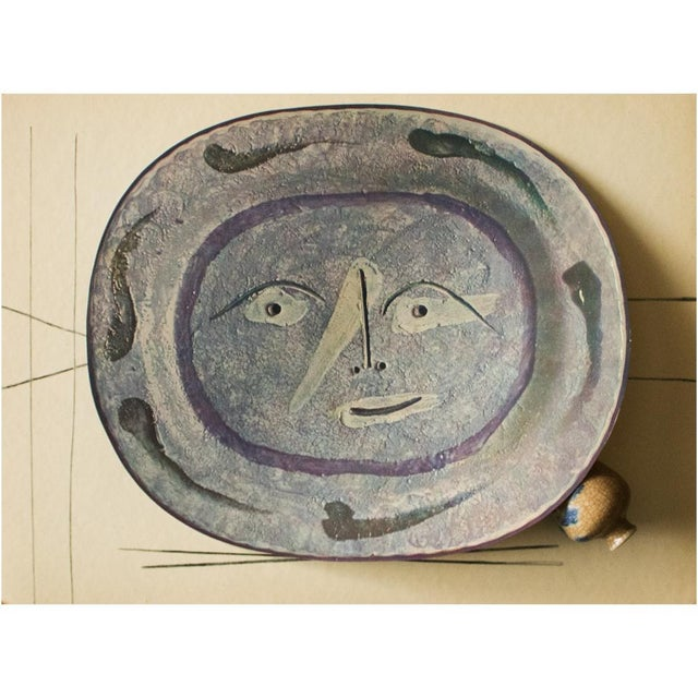 A rare exquisite original period offset lithograph of ceramic plate or charger by Pablo Picasso depicting smiling face....