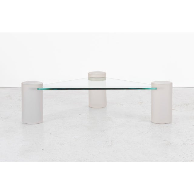A sculptural coffee table designed by Lion in Frost in the USA, circa 1970s. This piece has a glass top and three frosted...
