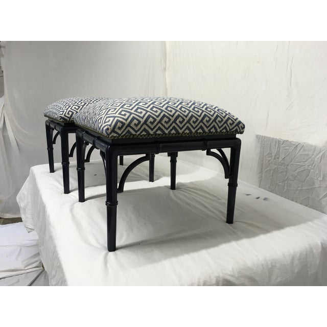 Pair of Tomlinson side tables, turned into benches/ stools. Faux bamboo frame is lacquered a navy blue , with an updated...
