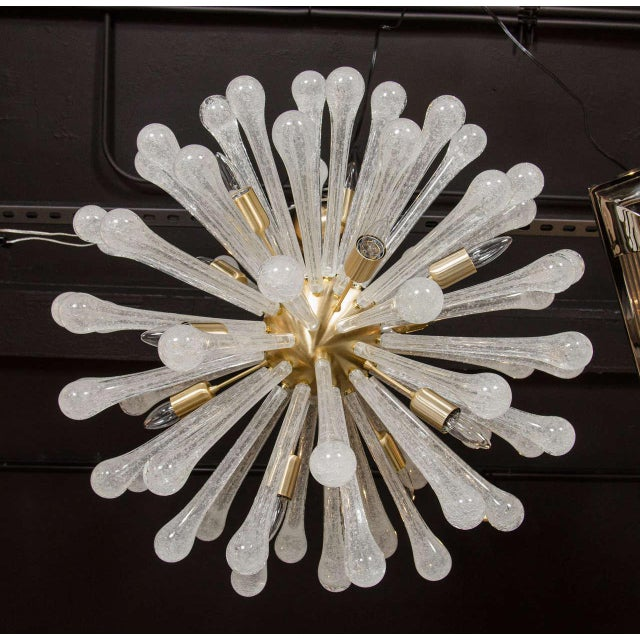 This magnificent Murano glass sputnik style chandelier features large tapered textured glass rods with ball like ends that...