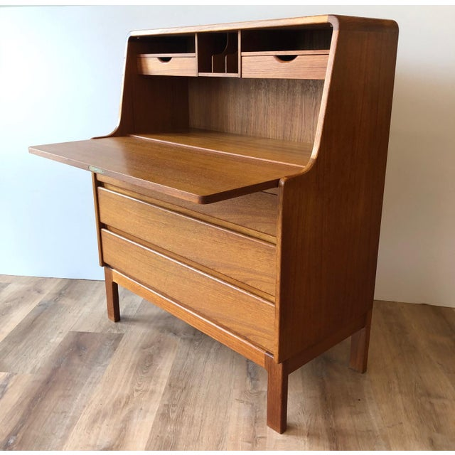 Danish modern teak secretary desk with drop leaf and two keys. Made in the 1970s.