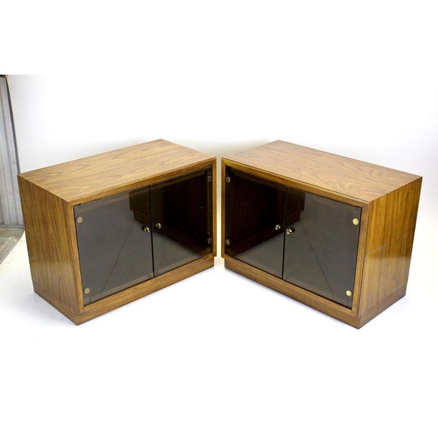 Mid-century pair of walnut cabinets with glass doors These cabinets are solid built with middle glass shelves They will...