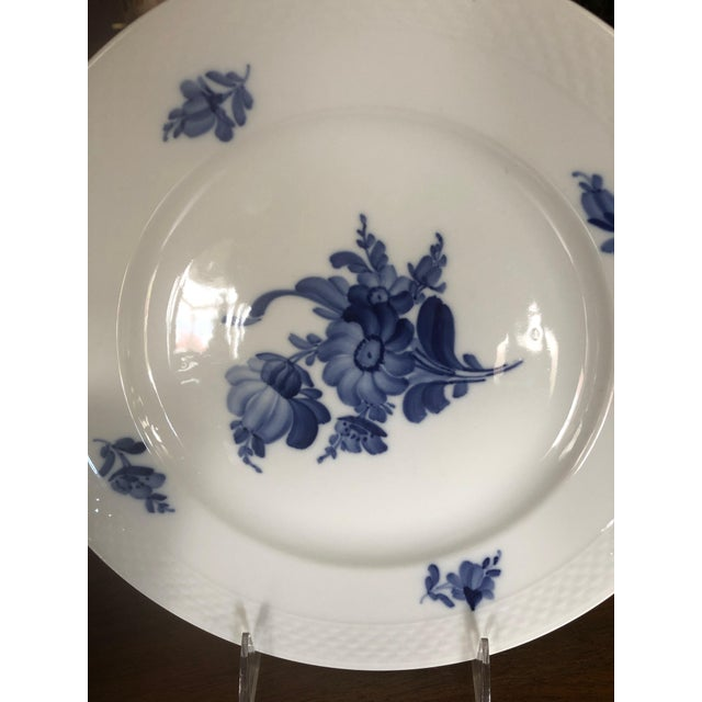 Lovely service or dinner plates, a set of 10, having pretty blue and white flowers and raised basket weave design around...