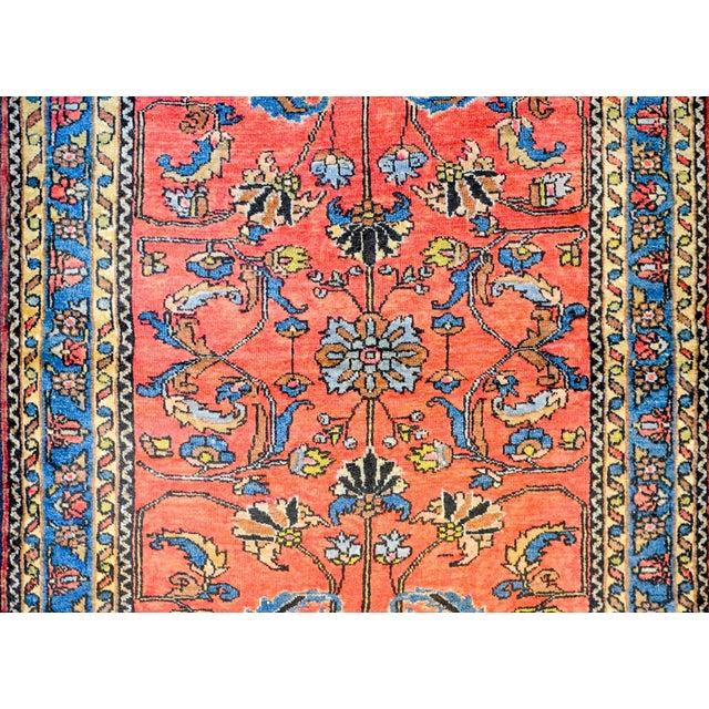 An early 20th century Persian Lilihan rug with a beautiful mirrored tree-of-life pattern woven in indigo, orange, yellow...