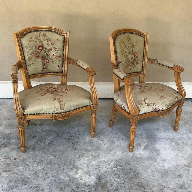 Pair of Louis XVI French Aubusson Tapestry Fruitwood Armchairs was hand-crafted from solid apple wood in one of the more...