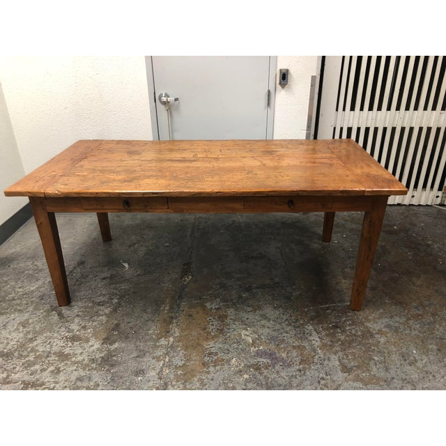 Design Plus Gallery presents a rustic farmhouse style dining table constructed entirely from reclaimed wood. Perfect for a...