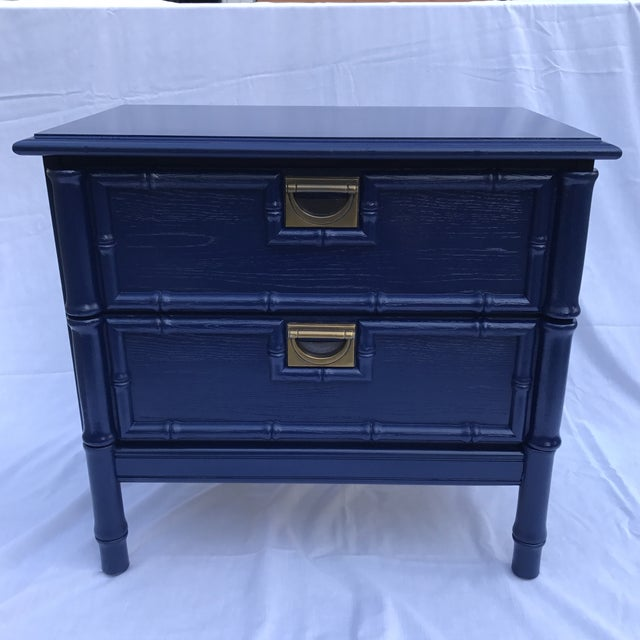 Fantastic vintage side table with bamboo-motif borders, two drawers with original brass pulls, and a fresh coat of navy...