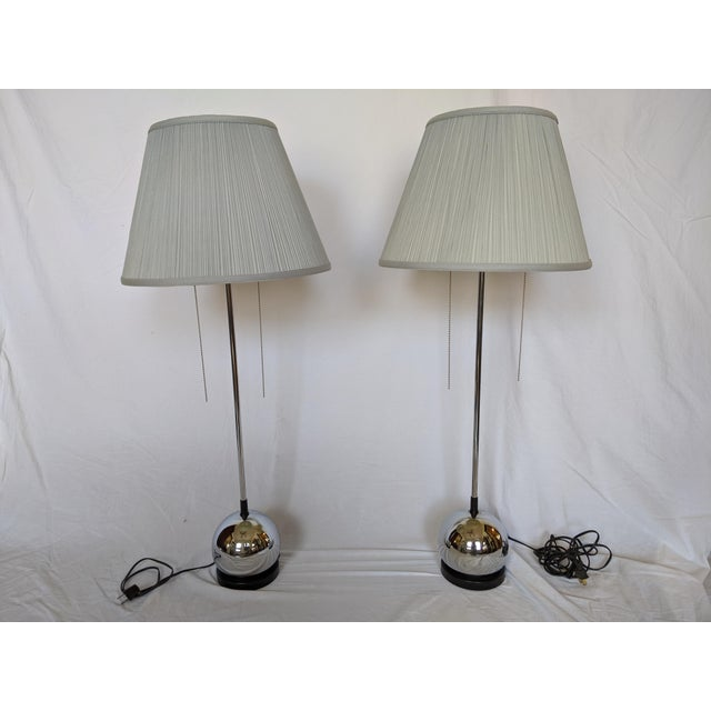 A truly one of a kind set! These striking table lamps with a signature polished chrome ball base are attributed to George...