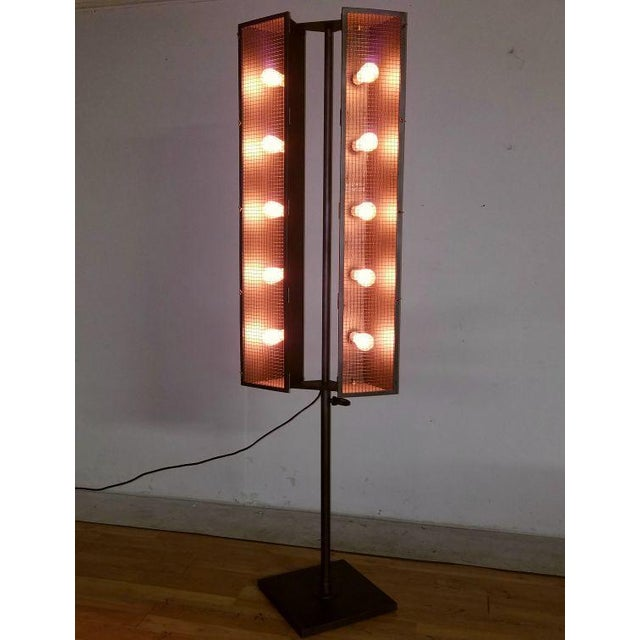 Amazing large floor lamp, solid metal industrial floor lamp, it measures about 7 feet tall. Swivel head lamps, excellent...