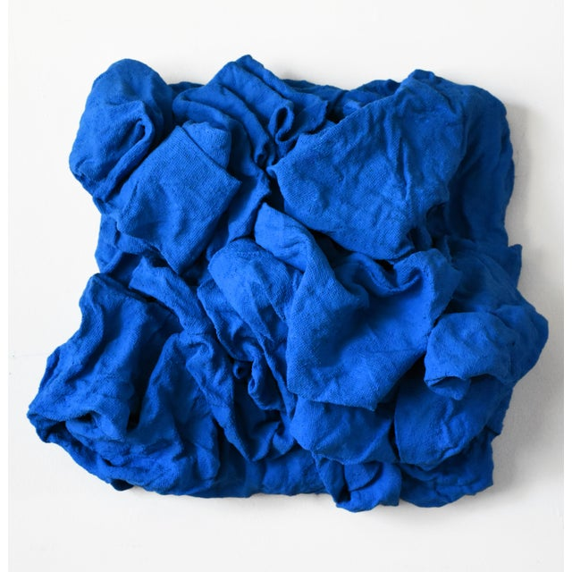 """""""Electric Blue Folds"""" is a mixed media wall sculpture made with burlap and paint on a wooden box. The elegant folds are..."""