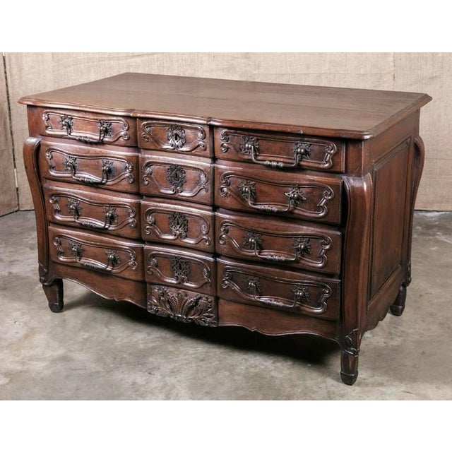 Rare 18th century period, French, Louis XV commode having three small top drawers over three single drawers with faux...