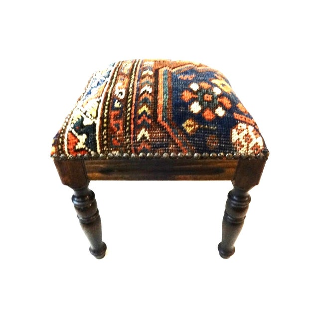 Elegant square wood stool upholstered in a superb antique handmade tribal Qashqa'i. This stool has four legs. Circa late...