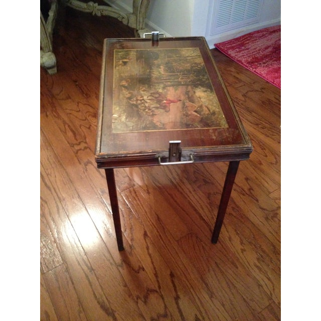 Antique Ferguson Treasured Furniture No. 721 . The top depicts a hunting scene, while the table itself is crafted of both...