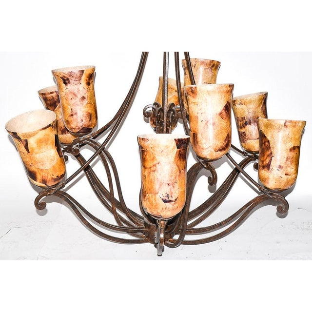 A Kalco Lighting chandelier in the Somerset pattern. This contemporary chandelier features a blackened-bronze colored...
