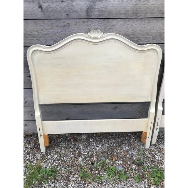 Set of 2 beautiful Drexel Touraine French Provincial style twin headboards. Heavy solid wood with graceful curves and...