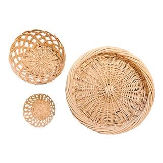 Vintage Boho Chic Rattan Basket Trio - Set of 3 For Sale