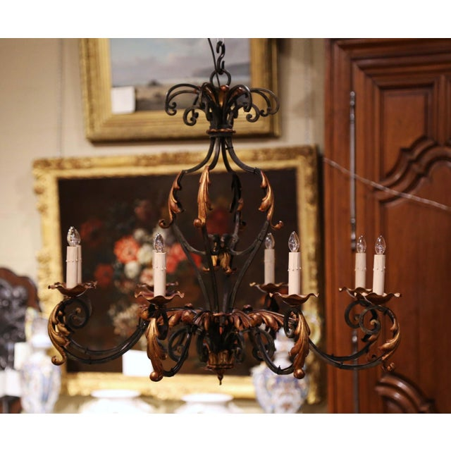 This elegant, antique chandelier was created in Paris, France circa 1920. Round in shape, the Louis XV style iron...