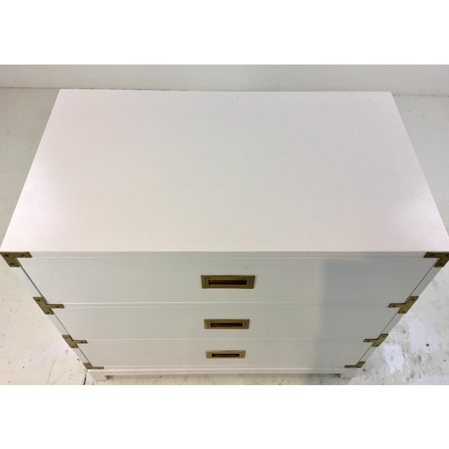 Stylish Ave Home modern white Carlyle campaign chest of drawers, three drawers, brass accents, showroom floor sample,...