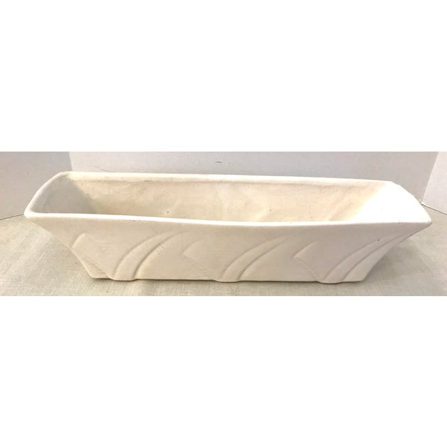 This is a beautiful cream or white colored long rectangular planter. The piece is marked Floraline on the bottom. This was...